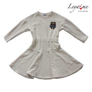 Платье детское бежево-молочное с воланом, спущенным плечом и нашивкой на лифе