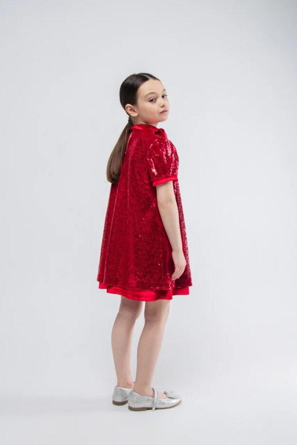 Платье трапеция на девочку из красных пайеток с бантом - шарфом. 2021 1