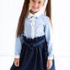Голубая школьная блузка с белой планкой и бантами